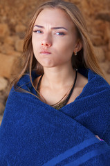 A girl sits in towel