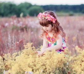 little girl with flowers outdoor