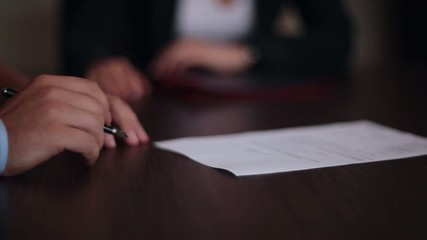 hand of  businessman signing  document or contract
