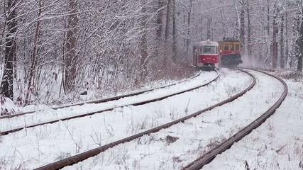 fairytale tram in snowy tunnel forest