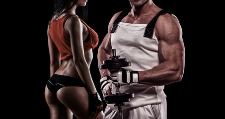 Strong Young Couple Working Out With Dumbbells - Shot In Studio
