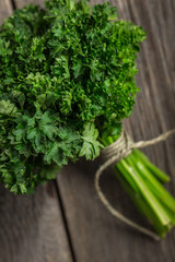 Organic fresh parsley on wooden background.