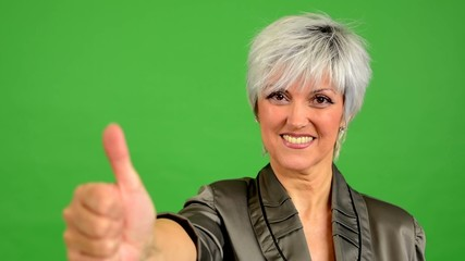 business woman shows thumb on agreement - green screen