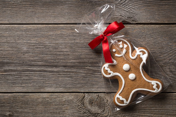 Packed gingerbread cookie on wooden background