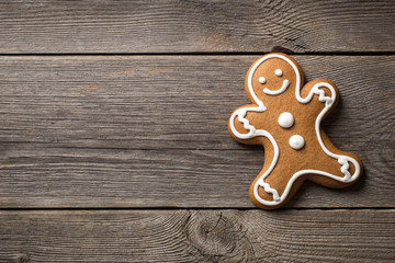Gingerbread cookie on wooden background