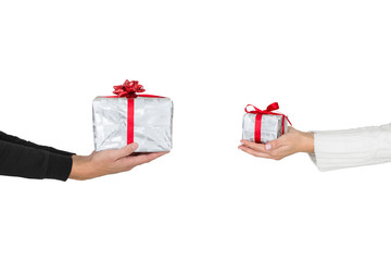 Man giving a Christmas gift to woman .Woman receiving a present.