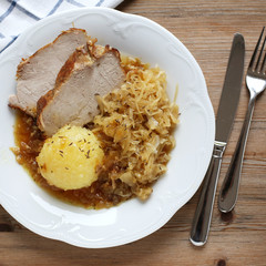 German Schweinebraten with potato dumpling and sauerkraut