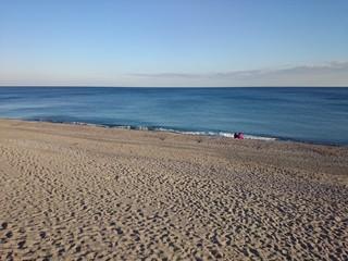 Persone in riva al mare