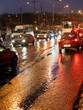 car driving in rainy evening