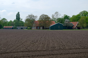 Farm in the Netherlands with plowed land