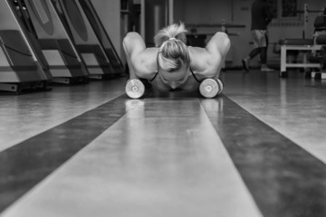 Woman push-ups on the floor.Gym woman push-up