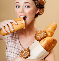 Beautiful woman with fresh fragrant bread. Crispy rolls. Bread B