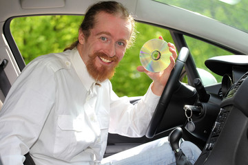 driver with CD, playing music in the car