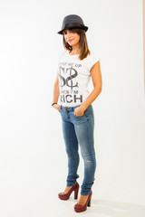 Young woman posing with fashion clothes