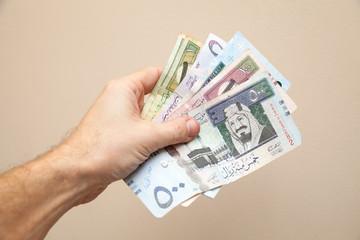 Modern Saudi Arabia money, banknotes in male hand