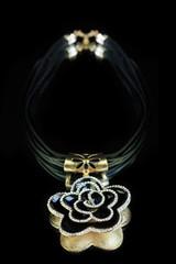 necklace. black flower