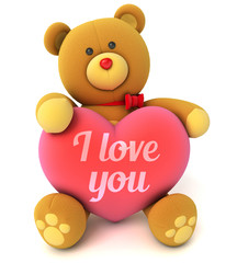 Toy teddy bear holding a heart with the words I love you
