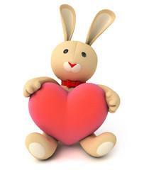Toy teddy bunny holding a big heart