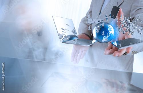 Leinwandbild Motiv businessman shows modern technology as concept