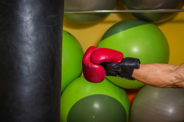 The man in boxing gloves, hit a punching bag, exercise