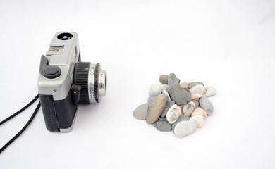 Pebbles and vintage camera