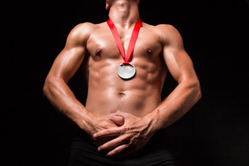 Bodybuilder with medal on his chest
