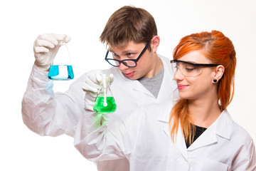 Two chemists holding a test tube in a lab