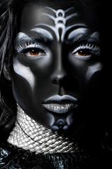 Close-up portrait of a woman with creative make-up