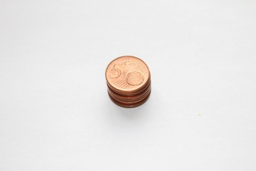 Piled up five cents on a white background