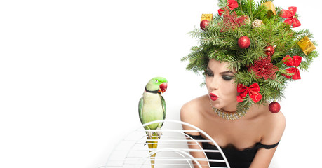 Beautiful girl with green parrot in studio