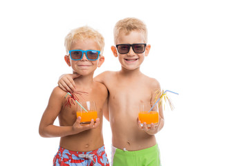 Two happy boys in sunglasses standing together, isolated on whit