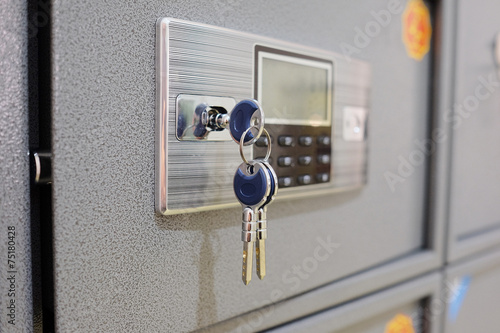 canvas print picture closeup deposit box with key