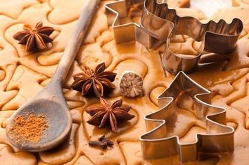 Christmas baking background dough, cookie cutters and  spices
