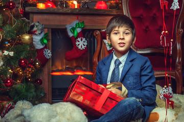 Portrait of teenager in jacket near New Year tree
