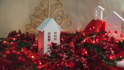 Beautiful Christmas composition with small house and garlands