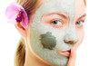 Skin care. Woman in clay mud mask on face. Beauty.