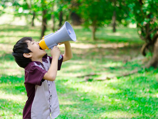 Little boy hold megaphone in the park