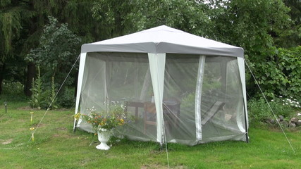 picnic tent in farm garden with mosquito protection