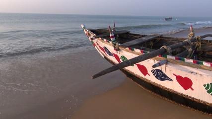 wooden fishing boat on Arabian sea beach in Odisha, India