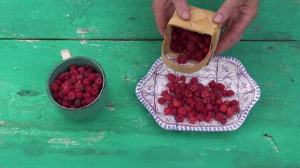 fresh sweet wild raspberry in decorative plate