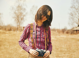 Happy girl holding vintage photo camera