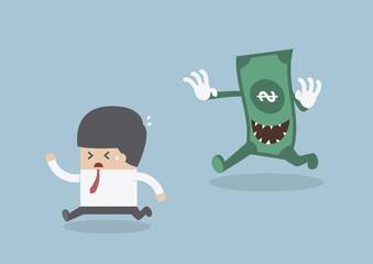 Businessman running away from the money monster