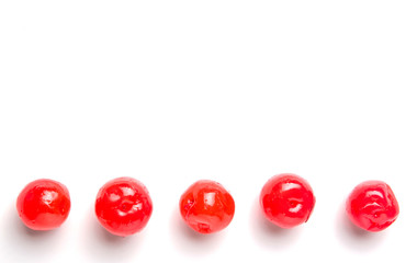 Pickled cherry fruit over white background