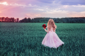 girl with flowers on field