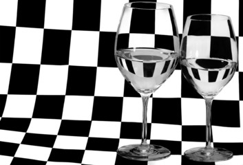 two glasses on black and white square background