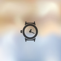 watch icon on blurred background