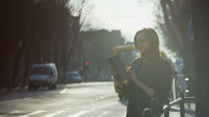Young woman with a tablet on the street pm