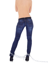 Sexy woman in high heel shoes with chains over white