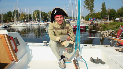 Simple guy wearing tricorn pirate hat, yachting, adventures