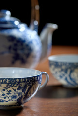 Old Chinese porcelain teapot, with two cups